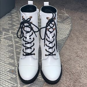 Shoe Dazzle white high heeled combat boots.